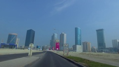 Bahrain - Driving through the Seef neighborhood of Manama Stock Footage