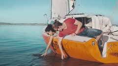 Young couple touching seawater Stock Footage