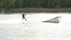Wakeboarder performing a 720 over a kicker [Slomo] Stock Footage