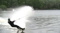 Wakeboarder spraying water [Slomo] Stock Footage