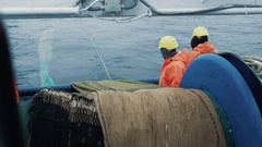 Team of Fishermen Unwind the Trawl Net during Commercial Fishing Stock Footage