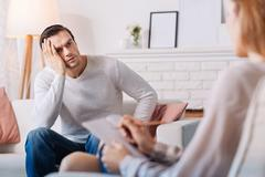 Troubled man talking about his problems Stock Photos