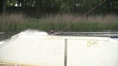 Wakeboarder performing a raley [Slomo] Stock Footage