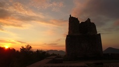 Old ruins in sun light in early morning with bold cloudy sunrise Stock Footage