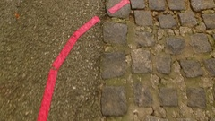 Following red line on a street pavement Stock Footage