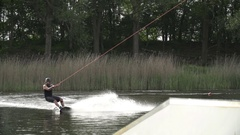 Wakeboarder tries to rotate 720 degrees but lands in the water [Slomo] Stock Footage