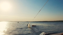 Water skiing riders on the lake surface Stock Footage
