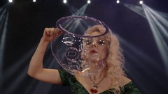 Woman is doing soap bubble show on the black background Stock Footage