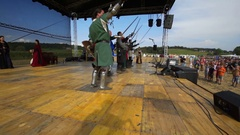 Knights are standing on stage and are lifting their swords up in the air Stock Footage