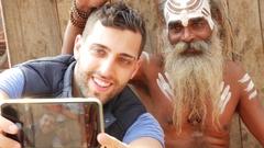 Tourist taking a selfie with Sadhu - Holy Man, in Varanasi, India Stock Footage