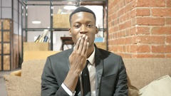 Flying Kiss by Black Businessman, Indoor Stock Footage