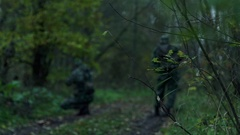Military in the forest perform a task Stock Footage