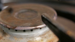 Gas burner cooker ignited. Very close up Stock Footage