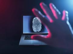 Computer Security, a finger print on a laptop illustrating a personnel password Stock Photos