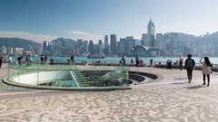 People walking along Tsim Sha Tsui promenade, Tsim Sha Tsui, Kowloon, Hong Kong Stock Footage
