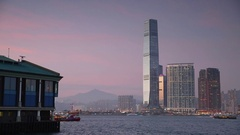 Star Ferry passing International Commerce Centre (ICC), Kowloon, Hong Kong Stock Footage