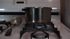 Cooking Pots On Stove With Flame and Steam Slider Left Stock Footage