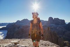 Female hiker arriving on Paternkofel mountain peak, Dolomites, Sexten, South Stock Photos