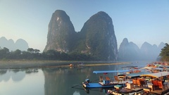 Boats on Li River, Xingping, Yangshuo, Guangxi, China Stock Footage