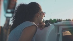 Charming young girl looks afar floating the sailboat Stock Footage