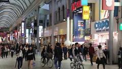 People walking through Hon-Dori Arcade, Hiroshima, Japan Stock Footage