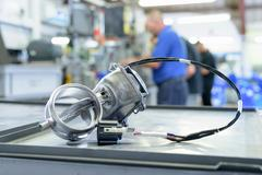 Exhaust valve with actuator on production line in factory Stock Photos