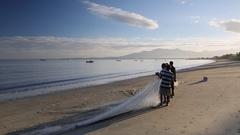 Fishermen on New Town Beach, Viti Levu, Fiji Stock Footage