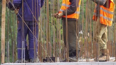 Group of builders measure the level of rebar installation at the construction Stock Footage