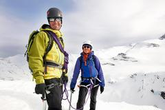Mountaineers on snow-covered mountain looking at camera smiling, Saas Fee, Stock Photos