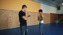Training sparring two young guys in the hall of MMA Stock Footage