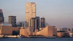 Star Ferry and boats passing Tsim Sha Tsui skyline, Kowloon, Hong Kong Stock Footage