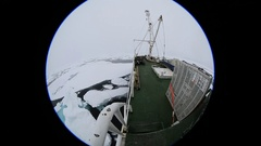 Extreme wide angle (porthole style) view of ice breaker bows breaking through Stock Footage