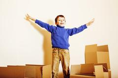 Little cute boy in empty room, remoove to new house. home alone, lifestyle Stock Photos