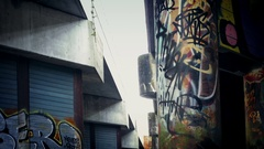 Moving Past Grungy Urban Area With Graffiti Stock Footage