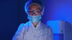 The woman hold a plasma blood under UV-lamp Stock Footage