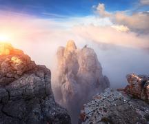 Mountain landscape at sunset. Amazing view from mountain peak Kuvituskuvat