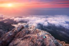 Mountain landscape at sunset. Amazing view from mountain peak. Evening Kuvituskuvat
