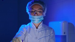 The woman in the laboratory seeing at the the plasma blood in tube Stock Footage