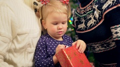 Little girl unboxing christmas gift. Close up shot Stock Footage