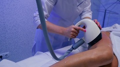 Anticellulite procedure on the tigh of the woman in beauty clinic Stock Footage