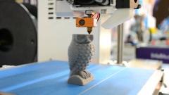 3D printer prints a figure close Stock Footage