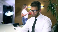 Businessman in glasses works behind a computer closeup Stock Footage