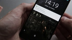 Closeup of finger touching a android smartphone to unlock Stock Footage
