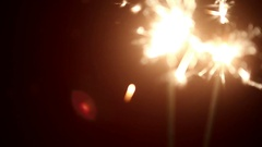 Two sparkler shining bright with red background Stock Footage