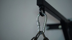 Mount carabiner of punching bag in hall fighting arts Stock Footage
