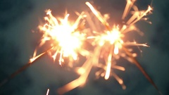 Two sparkler shining bright with blue background Stock Footage