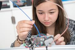 girl in robotics class research electronic device Kuvituskuvat