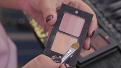 Close up shot. Make-up artist taking eye shadows from makeup eyeshadows palette Stock Footage