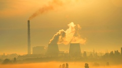 City urban landscape silhouette smoke pipe factory at sunrise sunset Stock Footage