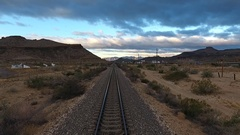 Low aerial shot of railroad tracks in a scenic valley Stock Footage